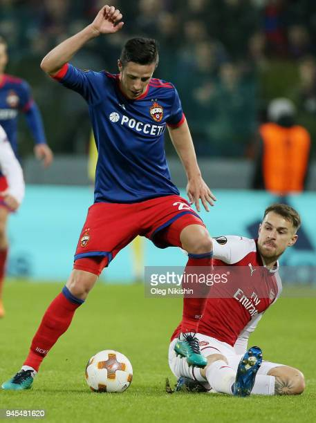Roman Eremenko of PFC CSKA Moskva vies for the ball with Aaron Ramsey of Arsenal FC during the UEFA Europa League quarter final leg two match between...