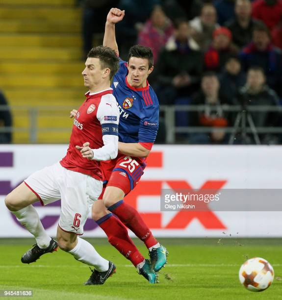 Roman Eremenko of PFC CSKA Moskva vies for the ball with Laurent Koscielny of Arsenal FC during the UEFA Europa League quarter final leg two match...