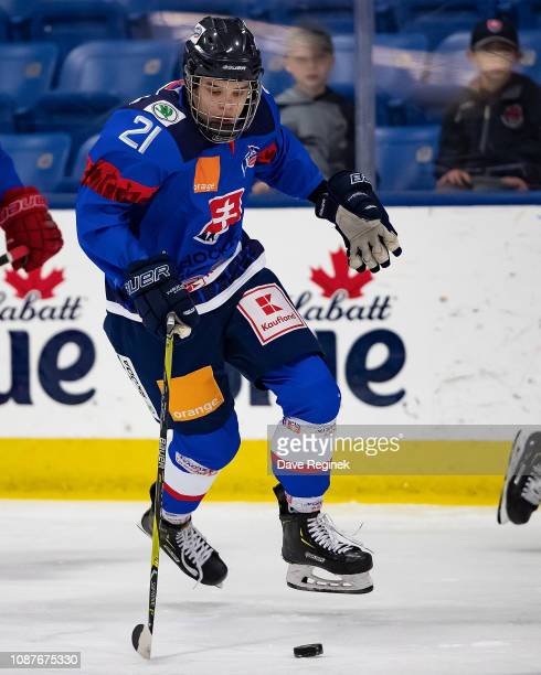 Roman Faith of the U17 Slovakia Nationals skates up ice with the puck against the Russian Nationals during day2 of game one of the 2018 Under17 Four...