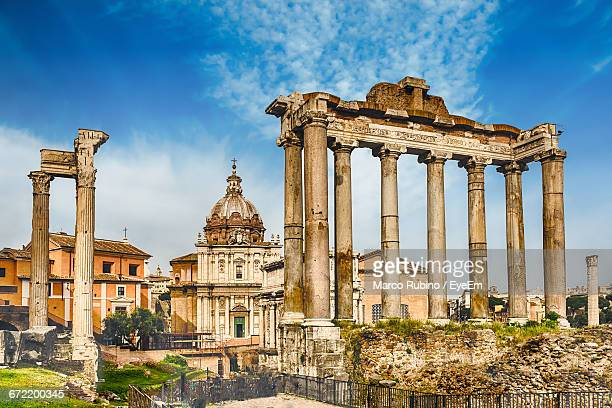 roman forum against sky in city - roman forum stock pictures, royalty-free photos & images