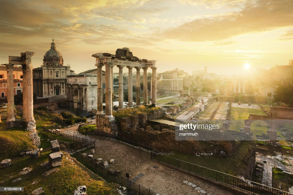 Roman Forum at sunrise, from left to right: Temple of Vespasian and Titus, church of Santi Luca e Martina, Septimius Severus Arch, ruins of Temple of Saturn. : Stock Photo