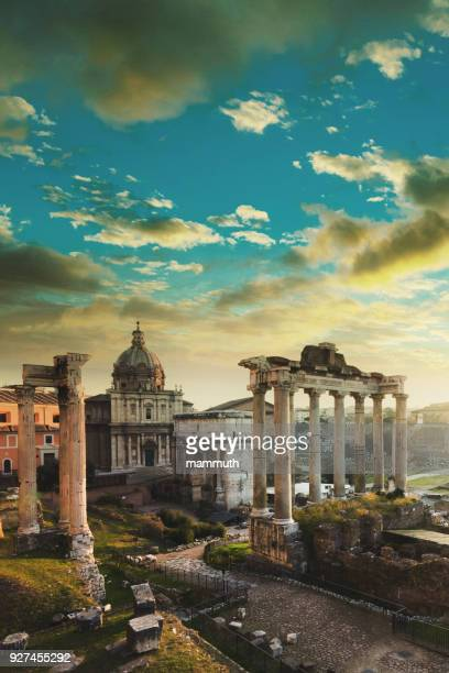 Roman Forum at sunrise, from left to right: Temple of Vespasian and Titus, church of Santi Luca e Martina, Septimius Severus Arch, ruins of Temple of Saturn