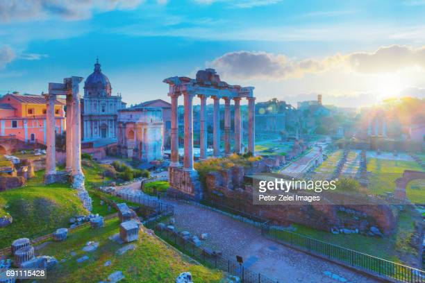 roman forum at sunrise - arch of septimus severus stock pictures, royalty-free photos & images
