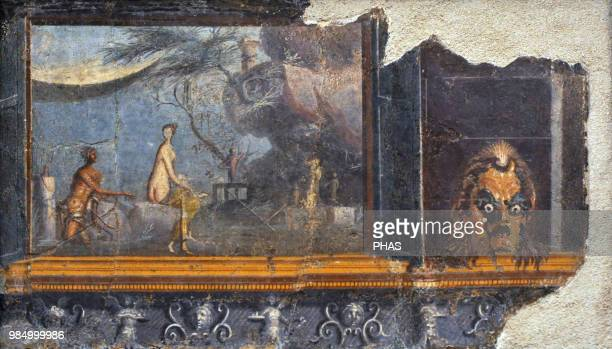 Roman fresco depicting a panel with doors with a mask of Silenus. To the left, the encounter of Acis and Galatea in a rural landscape, near a cave....
