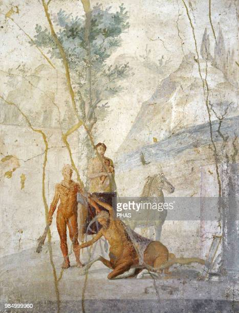 Roman fresco depicting Heracles grabbing the centaur Nessus by the hair Behind them Deianira House of Jason Pompeii National Archaeological Museum...