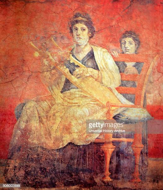 Roman fresco, discovered in Pompeii, depicits a woman seated on a bronze chair, with a back, playing a Greek musical instrument called a Kithara....