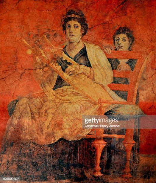 A Roman fresco discovered in Pompeii depicits a woman seated on a bronze chair with a back playing a Greek musical instrument called a Kithara Chairs...