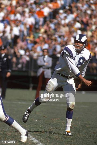 Roman Gabriel of the Los Angeles Rams throws a pass against the Atlanta Falcons during an NFL football game October 1, 1972 at Atlanta Stadium in...