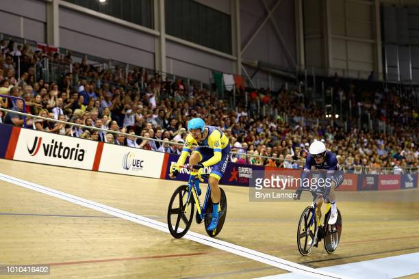 Roman Gladysh of Ukraine crosses the line to beat Adrien Garel of France and win gold in the Mens 15km Scratch Race during the track cycling on Day...