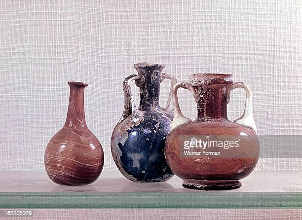 Roman glass from Syria Small bottles like this are often found in Roman burials holding perfume offerings for the dead Roman 64 BC 31 AD Syria