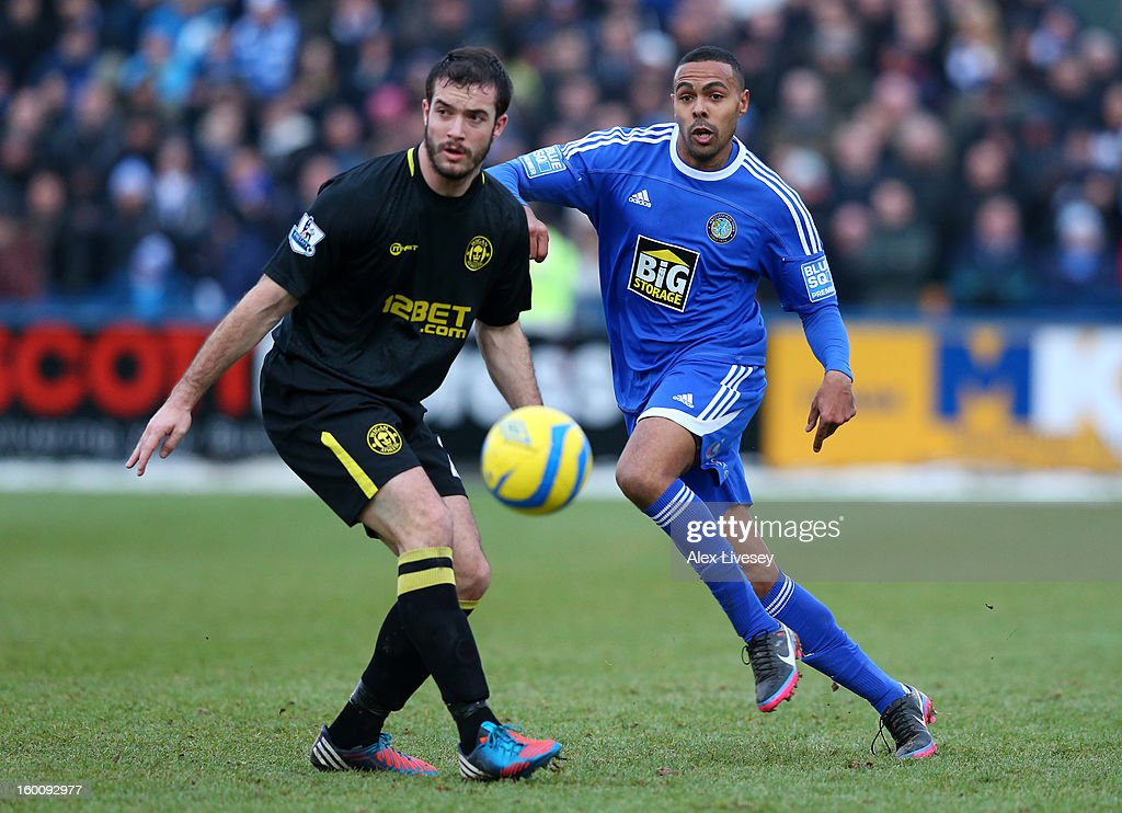 Roman Golobart of Wigan Athletic and Matthew Barnes-Homer of Macclesfield Town compete for the ball during the Budweiser FA Cup fourth round match between Macclesfield Town and Wigan Athletic at Moss Rose Ground on January 26, 2013 in Macclesfield, England.