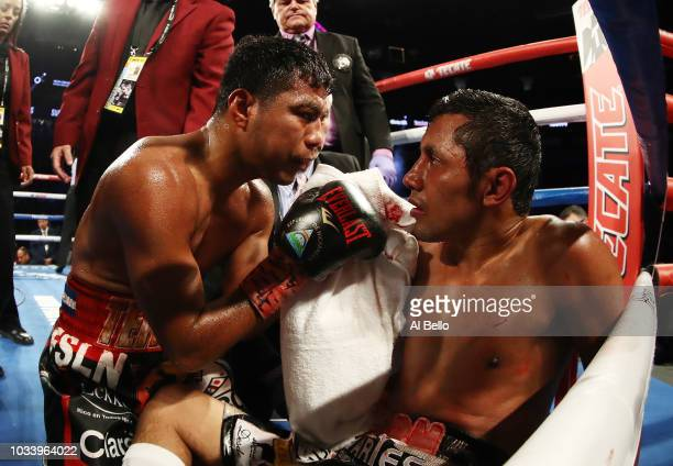 Roman Gonzalez consoles Moises Fuentes after knocking him out in the fifth round during their super flyweight bout at TMobile Arena on September 15...