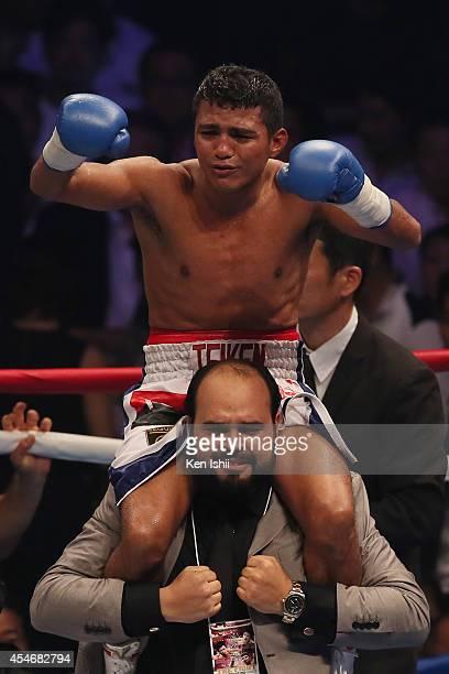 Roman Gonzalez of Nicaragua celebrates his winnig over Akira Yaegashi of Japan during the WBC flyweight title bout between Akira Yaegashi of Japan...