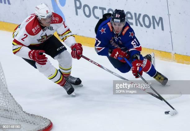 Roman Graborenko of HC Kunlun Red Star and Yegor Rykov of HC SKA Saint Petersburg in action during the 2017/18 Kontinental Hockey League Regular...