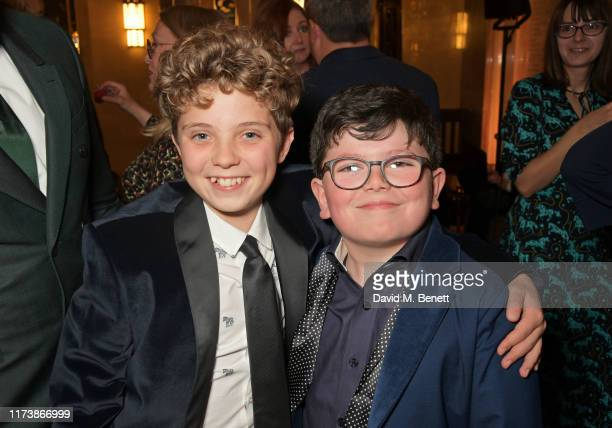 Roman Griffin Davis and Archie Yates attend The Academy Of Motion Pictures Arts And Sciences 2019 New Members Party during the 63rd BFI London Film...