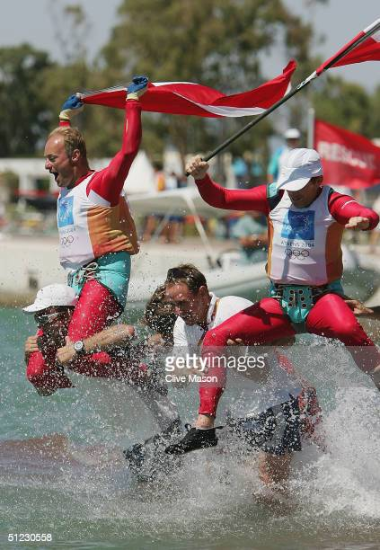 Roman Hagara and Hans Peter Steinacher of Austria celebrate gold in the open multihull tornado finals race on August 28 2004 during the Athens 2004...