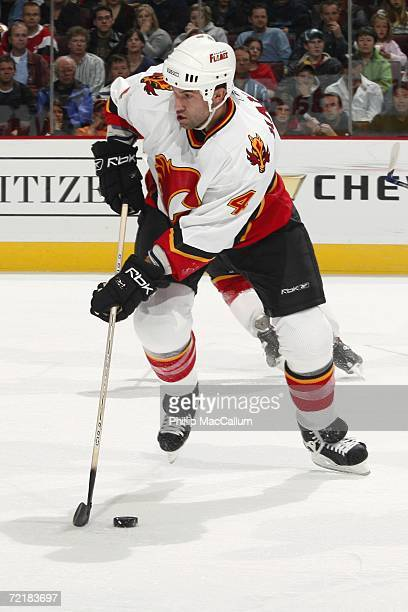 Roman Hamrlik of the Calgary Flames skates with the puck during a game against the Ottawa Senators at the Scotiabank Place on October 12, 2006 in...