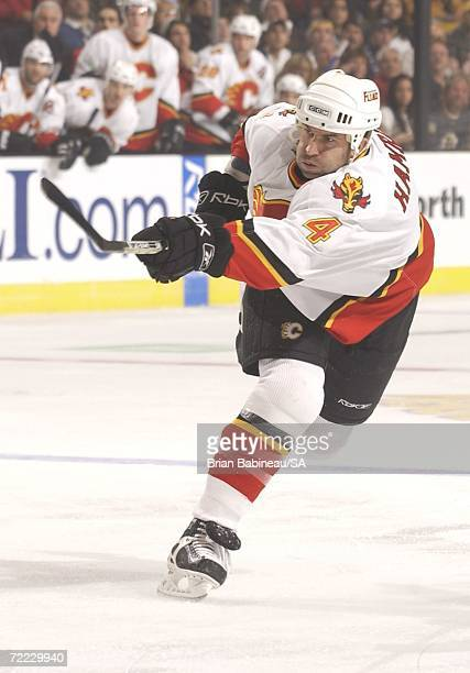 Roman Hamrlik of the Calgary Flames takes a slapshot against the Boston Bruins at the TD Banknorth Garden on October 19 2006 in Boston Massachusetts...