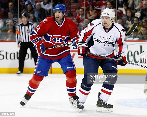 Roman Hamrlik of the Montreal Canadiens defends against Tomas Fleischmann of the Washington Capitals in Game Three of the Eastern Conference...