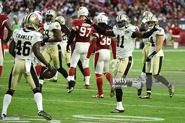 Roman Harper of the New Orleans Saints congratulates teammate Ken Crawley for recovering a fourth quarter fumble against the Arizona Cardinals at...