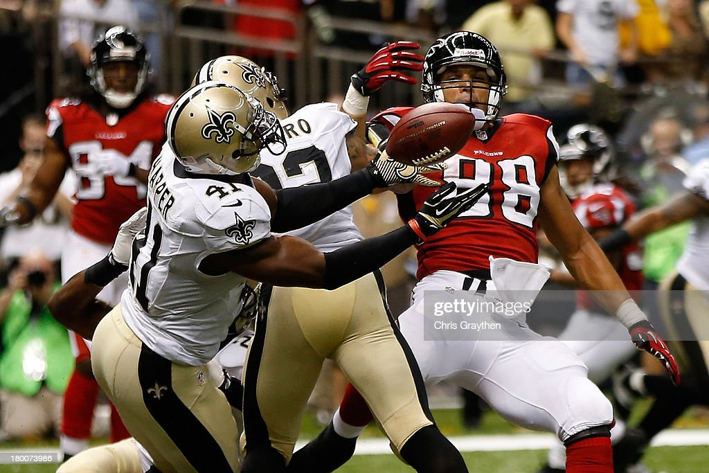 Roman Harper #41 of the New Orleans Saints intercepts a ball intended for Tony Gonzalez #88 of the Atlanta Falcons in the endzone at the Mercedes-Benz Superdome on September 8, 2013 in New Orleans, Louisiana.