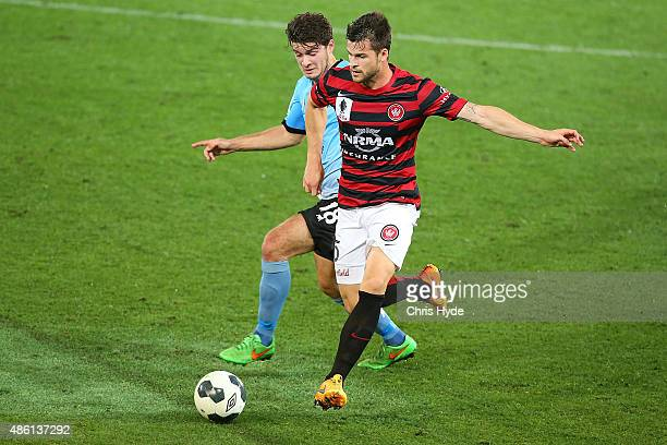 Roman Hoffman of the Sharks and Brendan Hamill of the Wanderers compete for the ball during the FFA Cup Round of 16 match between Palm Beach Sharks...
