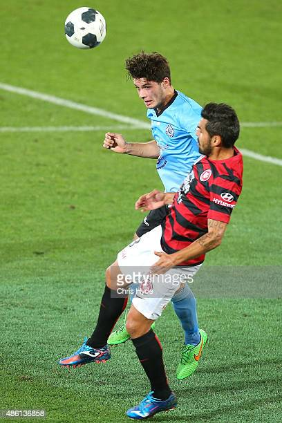Roman Hoffman of the Sharks heads the ball away from Dimas Delgado of the Wanderers during the FFA Cup Round of 16 match between Palm Beach Sharks...