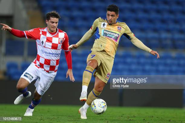Roman Hofmann of the Knights and Dimitri Petratos of the Jets compete for the ball during the FFA Cup round of 32 match between Gold Coast Knights...