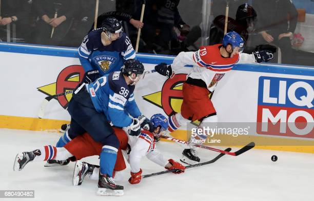 Roman Horak and Tomas Zohorna of Czech Republic in action with Joonas Jarvinen and Antti Pihlstrom of Finland during the 2017 IIHF Ice Hockey World...