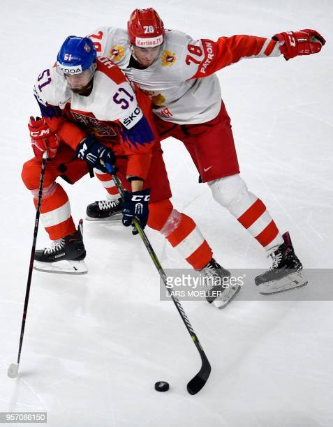 Roman Horak of Czech Republic vies for the puck with Maxim Mamin of Russia during the group A match Czech Republic vs Russia of the 2018 IIHF Ice...