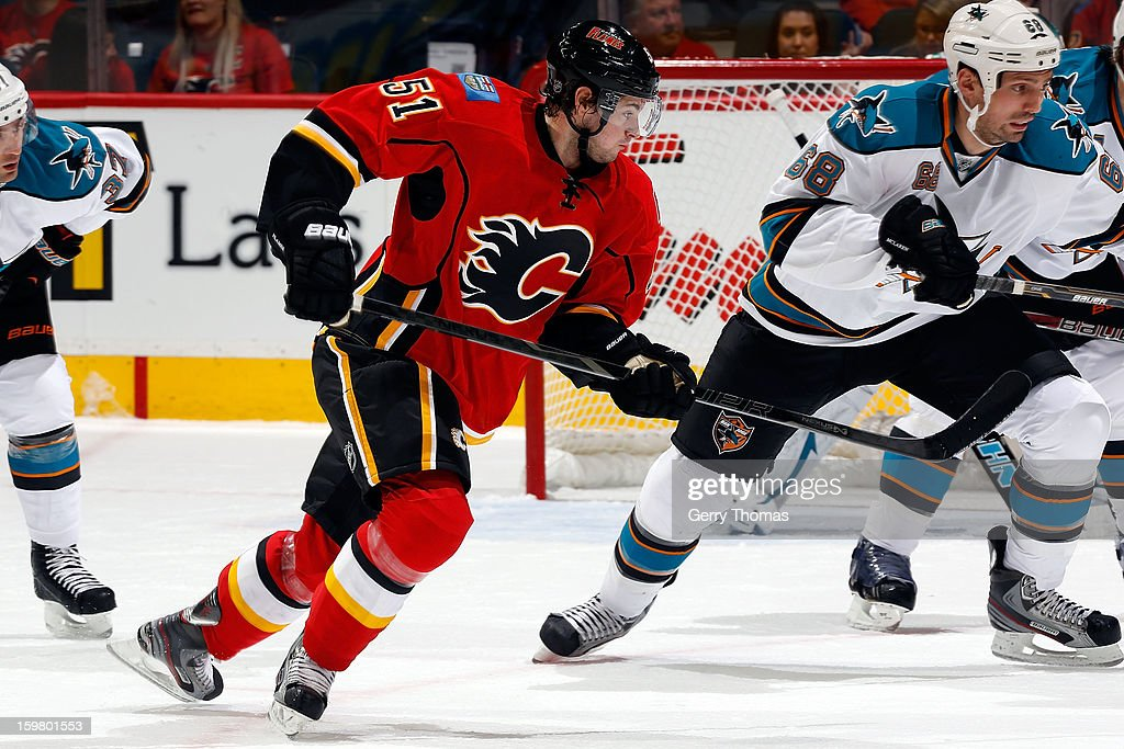 Roman Horak #51 of the Calgary Flames skates against Frazer McLaren #68 of the San Jose Sharks on January 20, 2013 at the Scotiabank Saddledome in Calgary, Alberta, Canada.