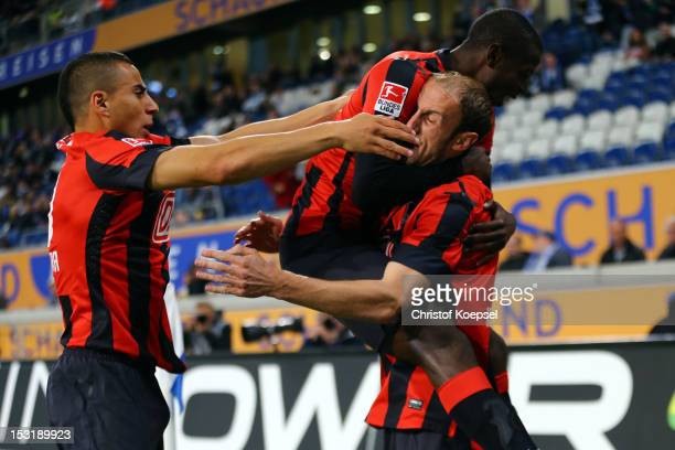 Roman Hubnik celebrates the first goal with Adrian Ramos and Aenis BenHatira of Berlin during the Second Bundesliga match between MSV Duisburg and...