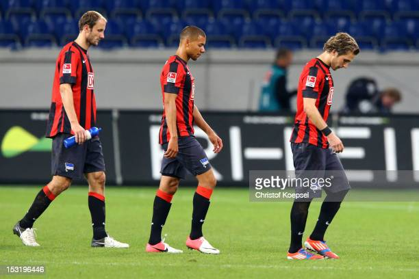 Roman Hubnik Marcel Ndjeng and Petar Pekarik of Berlin look dejected after the 22 draw of the Second Bundesliga match between MSV Duisburg and Hertha...