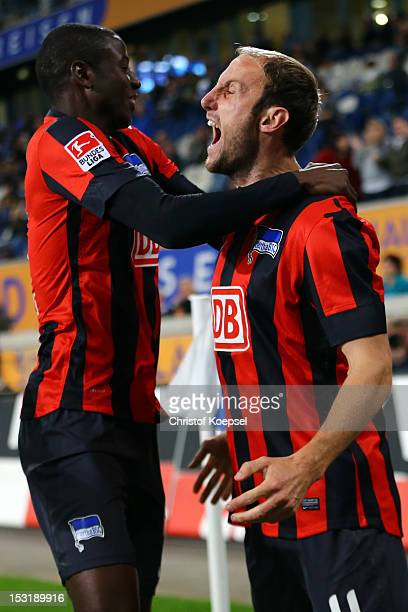 Roman Hubnik of Berlin celebrates the first goal with Adrian Ramos during the Second Bundesliga match between MSV Duisburg and Hertha BSC Berlin at...