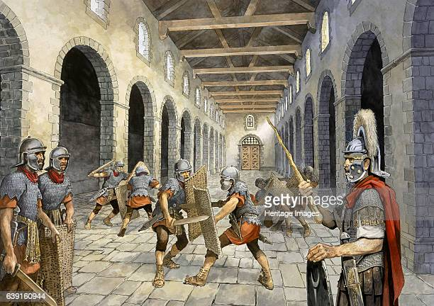 Roman infantry practising combat c3rd century Reconstruction drawing of Roman auxiliary infantry practising combat in the Drill Hall Banna now known...