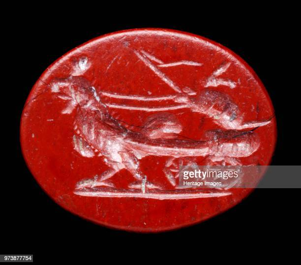 Roman jasper intaglio from Aldborough Roman town North Yorkshire Intaglio depicting a hare in a chariot being pulled by a cock Artist Unknown