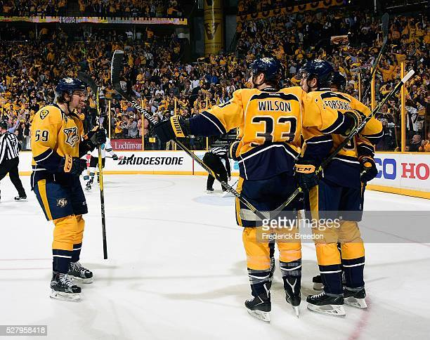 Roman Josi and Colin Wilson of the Nashville Predators congratulate teammate Filip Forsberg on scoring a goal against the San Jose Sharks during the...