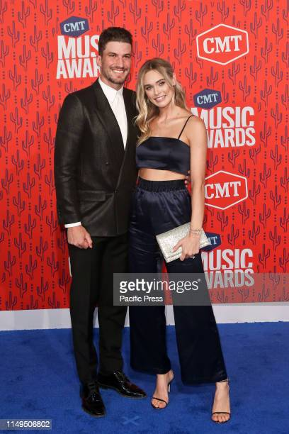 Roman Josi and Ellie attend the 2019 CMT Music Awards at the Bridgestone Arena in Nashville Tennessee