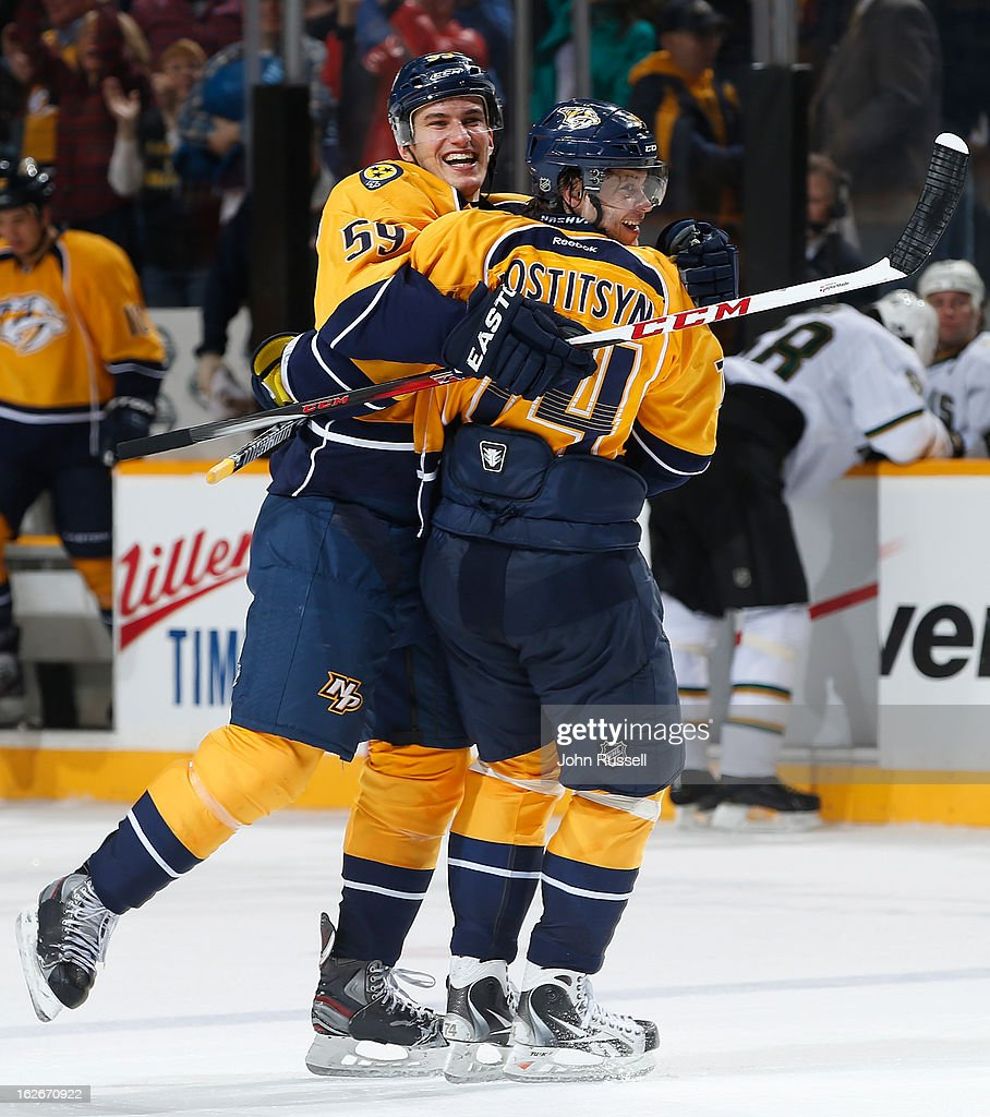 Roman Josi #59 celebrates his overtime game winner with Sergei Kostitsyn #74 of the Nashville Predators against the Dallas Stars during an NHL game at the Bridgestone Arena on February 25, 2013 in Nashville, Tennessee.