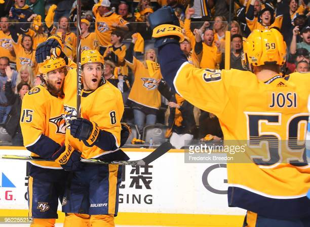 Roman Josi, Craig Smith, and Kyle Turris celebrate after a goal against the Winnipeg Jets during the third period of a 4-1 Jets victory in Game One...