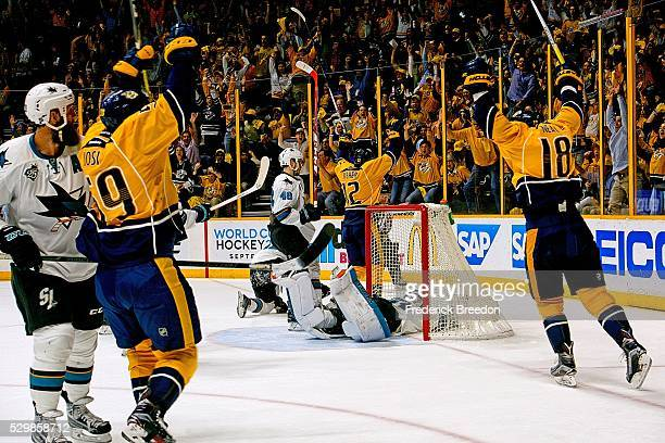 Roman Josi Mike Fisher and James Neal react after a goal against goalie Martin Jones of the San Jose Sharks during the first period of Game Six of...
