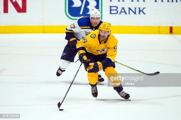 Roman Josi of the Nashville Panthers skates against Jaden Schwartz of the St Louis Blues during an NHL game at Bridgestone Arena on February 13 2018...