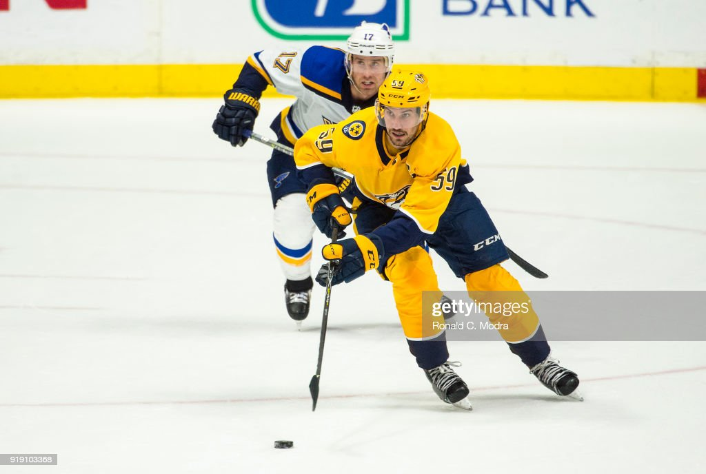 Roman Josi #59 of the Nashville Panthers skates against Jaden Schwartz #17 of the St. Louis Blues during an NHL game at Bridgestone Arena on February 13, 2018 in Nashville, Tennessee.