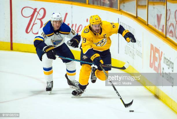 Roman Josi of the Nashville Panthers skates against Jay Bouwmeester of the St Louis Blues during an NHL game at Bridgestone Arena on February 13 2018...
