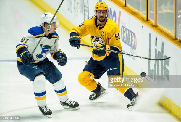 Roman Josi of the Nashville Panthers skates against Vladimir Tarasenko of the St Louis Blues during an NHL game at Bridgestone Arena on February 13...