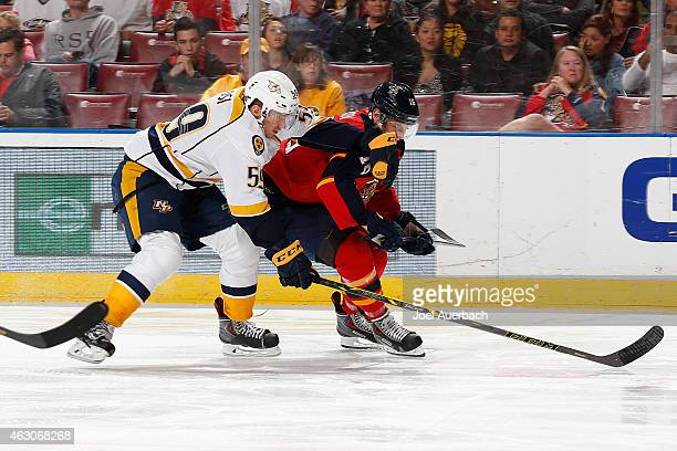 Roman Josi of the Nashville Predators and Aleksander Barkov of the Florida Panthers skate after a loose puck at the BBT Center on February 8 2015 in...