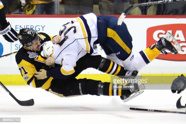 Roman Josi of the Nashville Predators and Evgeni Malkin of the Pittsburgh Penguins fight in the third period in Game Five of the 2017 NHL Stanley Cup...