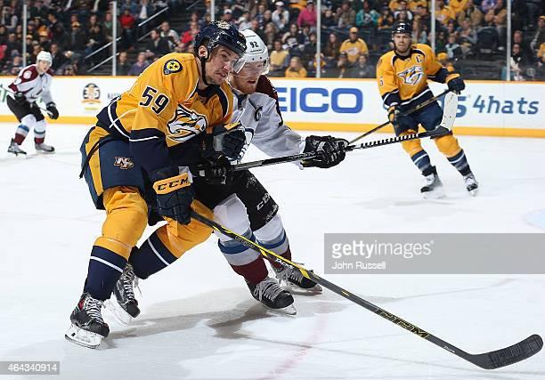 Roman Josi of the Nashville Predators battles against Gabriel Landeskog of the Colorado Avalanche during an NHL game at Bridgestone Arena on February...