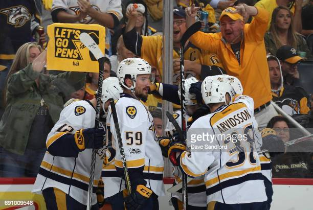 Roman Josi of the Nashville Predators celebrates with teammate Pontus Aberg after Aberg's first period goal in Game Two of the 2017 NHL Stanley Cup...