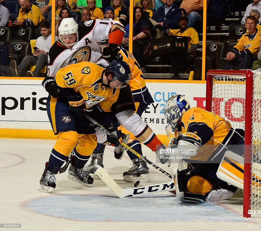 Roman Josi #59 of the Nashville Predators defends Corey Perry #10 of the Anaheim Ducks in front of Predators goalie Pekka Rinne #35 during the second period in Game Six of the Western Conference First Round during the 2016 NHL Stanley Cup Playoffs at Bridgestone Arena on April 25, 2016 in Nashville, Tennessee.